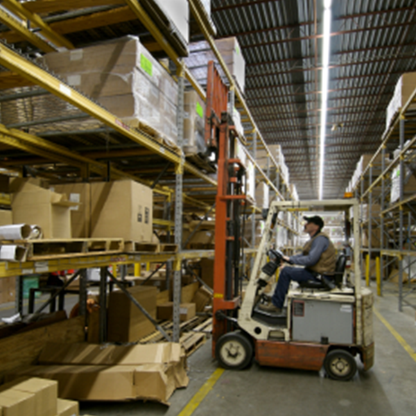 man operating a forklift in a storage facility